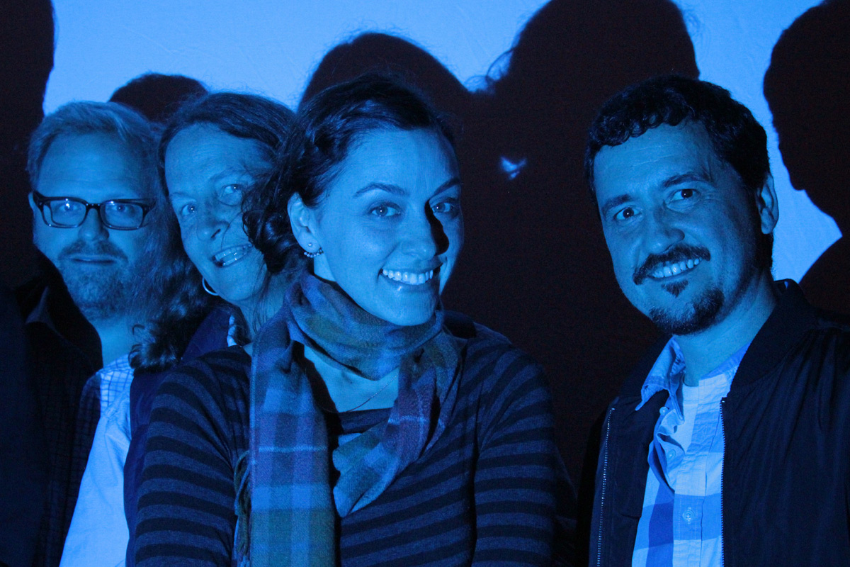 film makers and friends in front of the blue screen